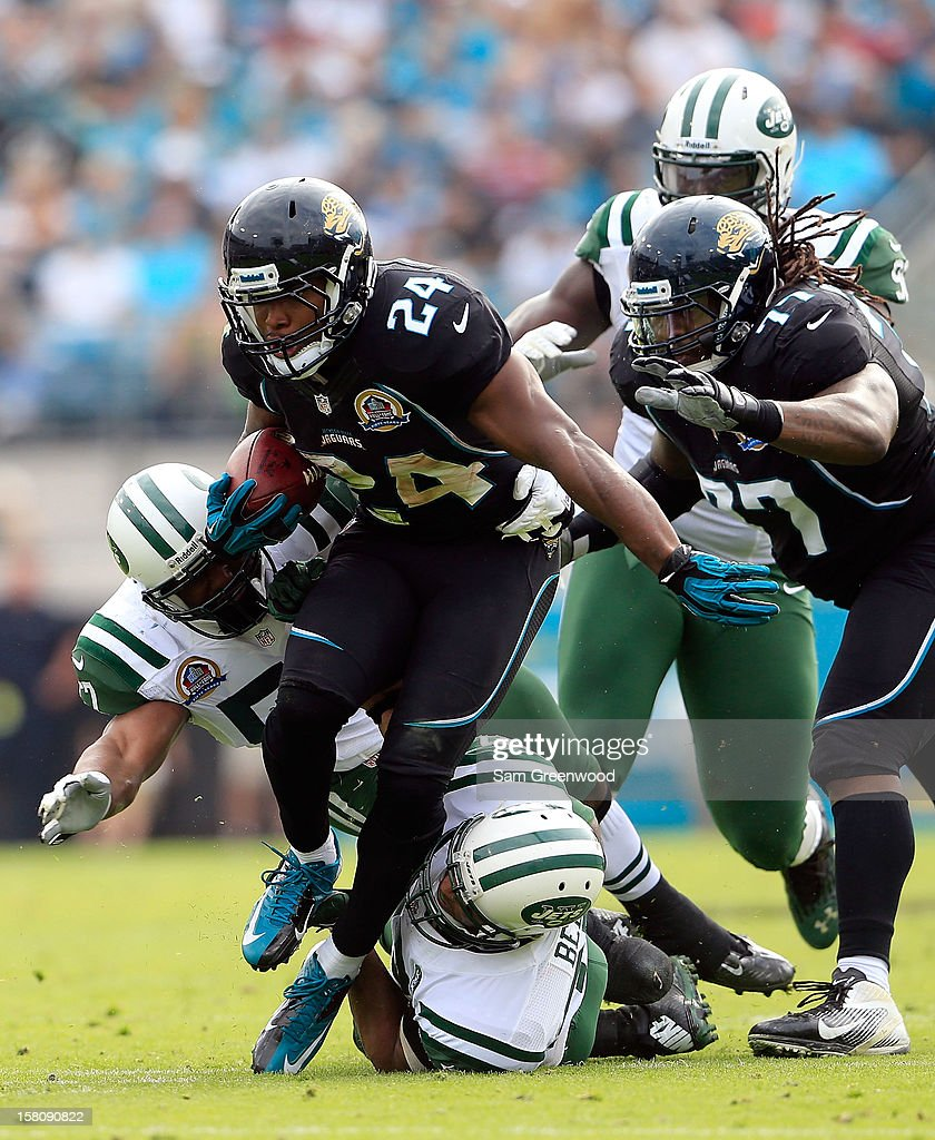 Montell Owens #24 of the Jacksonville Jaguars is tackled during the game against the New York Jets at EverBank Field on December 9, 2012 in Jacksonville, Florida.