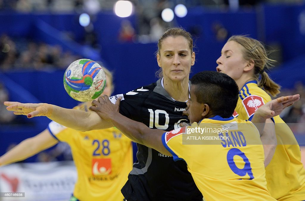 Montenegreo's Andjela Bulatovic (C) fights for the ball with Sweden's Louise Sand (2nd R), <a gi-track='captionPersonalityLinkClicked' href=/galleries/search?phrase=Isabelle+Gullden&family=editorial&specificpeople=4651166 ng-click='$event.stopPropagation()'>Isabelle Gullden</a> (R) and Ida Oden (L, hidden) during the bronze medal match of the Women's European Handball Championship on December 21, 2014 in Budapest.