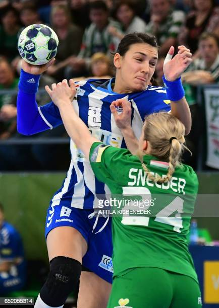 Montenegrian Buducnost's Cristina Neagu is fouled by FTC Rail Cargo Hungaria Danick Snelder of in Budapest on March 11 2017 during the EHF Women's...