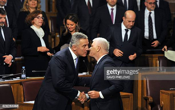 Montenegrin long time leader Milo Djukanovic greets the new Montenegrin Prime Minister Dusko Markovic during the nomination ceremony at the...