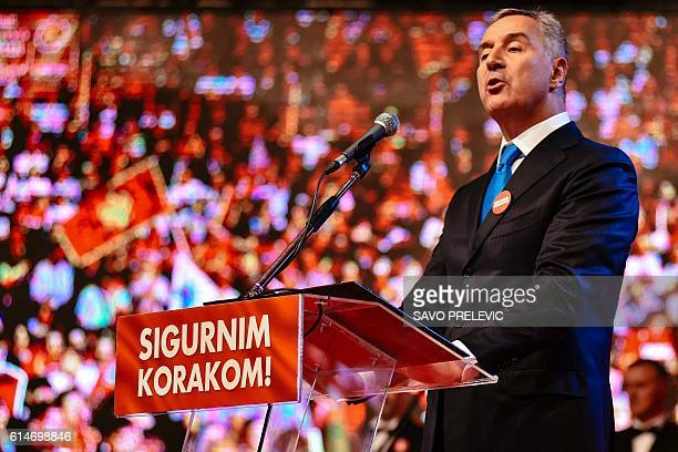 Montenegrin Prime Minister Milo Djukanovic speaks during an election rally in Podgorica on October 14 2016 NATO membership will be a central issue in...