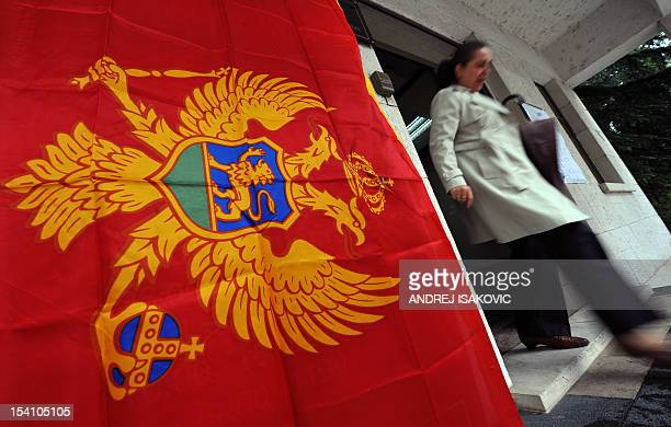 A Montenegrin woman walks out of a polling station in capital Podgorica on October 14 2012 Montenegro voted today to choose a government that will...