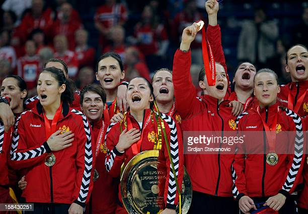 Montenegro handball team sing their national anthem with their trophy during the Women's European Handball Championship 2012 medal ceremony at Arena...