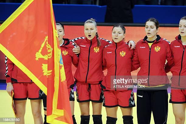 Montenegro players sing their national anthem prior to the 2012 EHF European Women's Handball Championship final match between Montenegro and Norway...