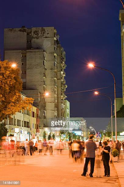 MONTENEGRO-Podgorica: Evening strollers on Bratstva-Jedinstva Street