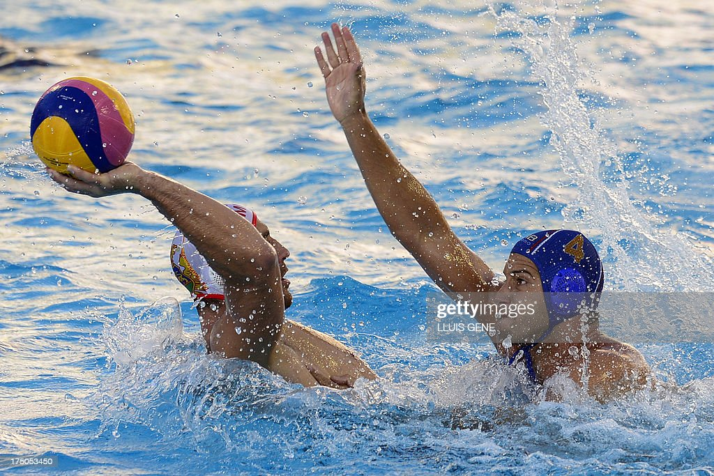 Montenegro's Aleksandar Ivovic vies with Serbia's Vanja Udovicic during their men's water polo quarterfinals match at the FINA World Championships at...
