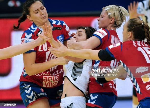Montenegro's Ana Dokic is fouled by Serbia's Sladana Pop–Lazic Serbia's Ivana Milosevic and Serbia's Jelena Eric during the the 2012 EHF European...