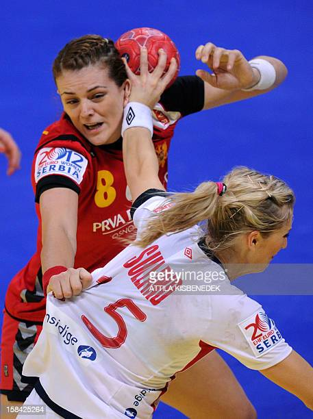Montenegro's Andrea Klikovac and Norway's Linn Jorum Sulland fight for the ball during the 2012 EHF European Women's Handball Championship final...