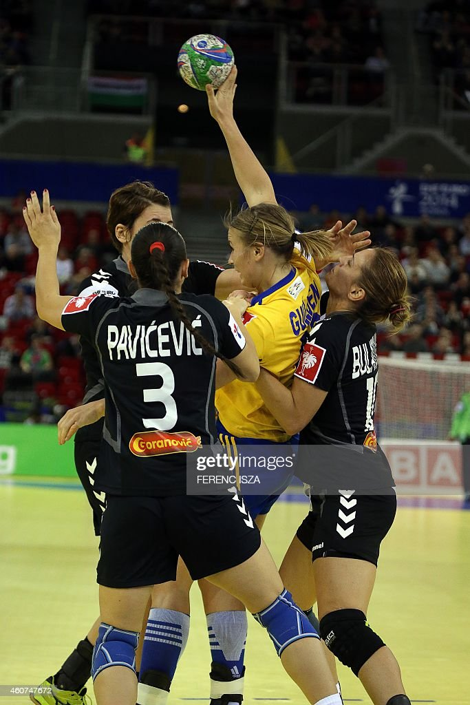 Montenegro's Biljana Pavicevic (L) and Andjela Bulatovic (R) fight for the ball with Sweden's <a gi-track='captionPersonalityLinkClicked' href=/galleries/search?phrase=Isabelle+Gullden&family=editorial&specificpeople=4651166 ng-click='$event.stopPropagation()'>Isabelle Gullden</a> during the bronze medal match of the Women's European Handball Championship on December 21, 2014 in Budapest.