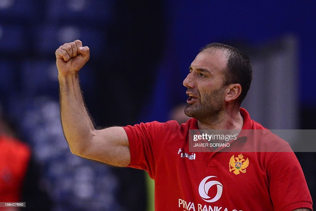 Montenegro's coach Dragan Adzic celebrates his team's victory at the end of the 2012 EHF European Women's Handball Championship final match Norway vs Montenegro on December 16 , 2012, at the Kombank Arena of Belgrade. AFP PHOTO / JAVIER SORIANO