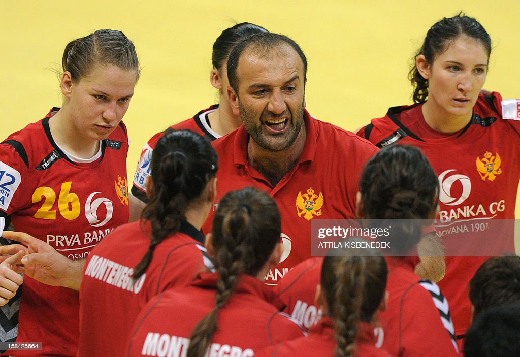 Montenegro's coach Dragan Adzic (C) directs his team during the 2012 EHF European Women's Handball Championship final match against Norway on December 16, 2012 at the Kombank arena in Belgrade.