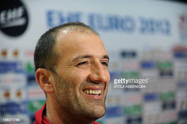Montenegro's coach Dragan Adzic listens to a journalist' questions on the media day of the 2012 EHF European Women's Handball Championship on...