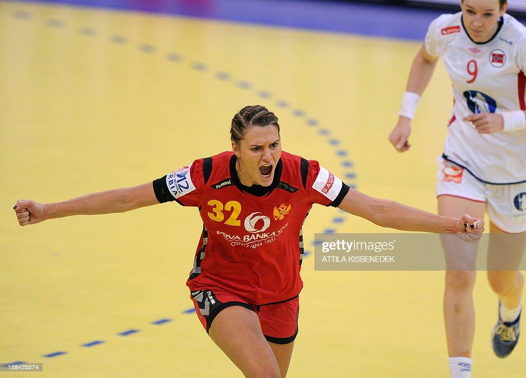 Montenegro's Katarina Bulatovic (L) celebrates her score against Norway's Kristine Lunde-Borgersen (R) during the 2012 EHF European Women's Handball Championship final match Norway vs Montenegro on December 16 , 2012, at the Kombank Arena of Belgrade.