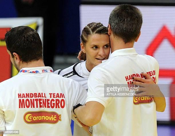Montenegro's Katarina Bulatovic celebrates with teammate Milena Knezevic after winning the 2012 EHF European Women's Handball Championship semifinal...