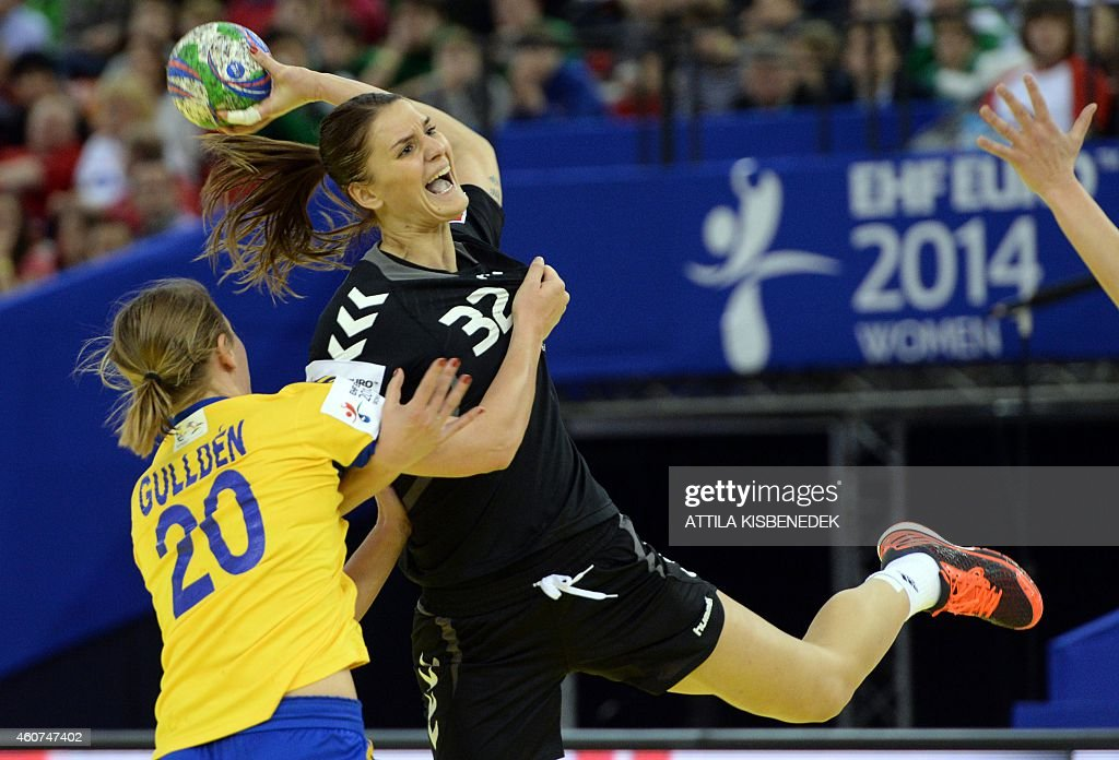 Montenegro's Katarina Bulatovic (R) vies with Sweden's Isabelle Gulldén (L) during the bronze medal match of the Women's European Handball Championship on December 21, 2014 in Budapest. AFP PHOTO / ATTILA KISBENEDEK
