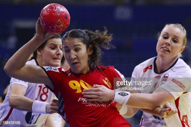 Montenegro's Milena Knezevic throws the ball past Norway's LinnKristin Riegelhuth Koren and Karoline Dyhre Breivang during the 2012 EHF European...
