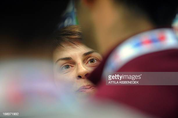 Montenegro's pivot Ana Dokic answers answers a journalist's question on the media day of the 2012 EHF European Women's Handball Championship on...