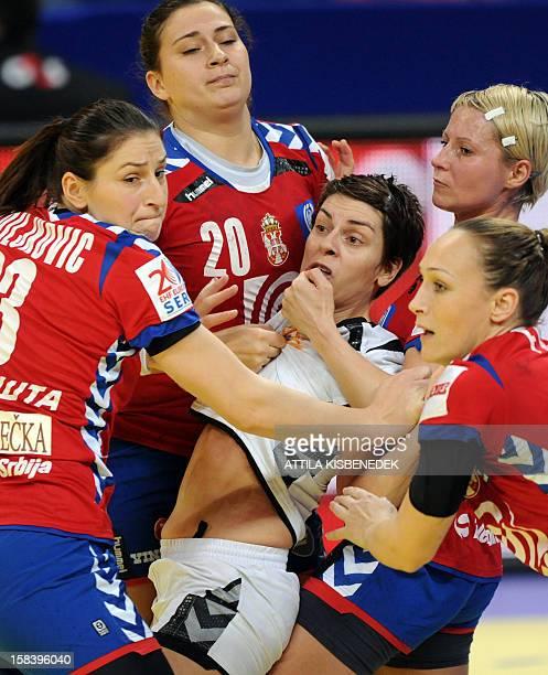 Montenegro's pivot Ana Dokic is fouled by Serbia's Jovana Stoiljkovic Serbia's Sladana Pop–Lazic Serbia's Ivana Milosevic and Serbia's Jelena Eric...
