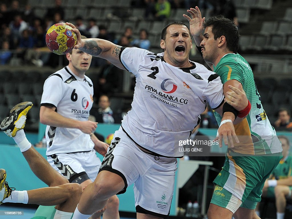 Montenegro's pivot Mladen Rakcevic (L) vies with Brazil's right back Fernando Jose Pacheco (R) during the 23rd Men's Handball World Championships preliminary round Group A match Montenegro vs Brazil at the Palau Sant Jordi in Barcelona on January 18, 2013. AFP PHOTO/ LLUIS GENE