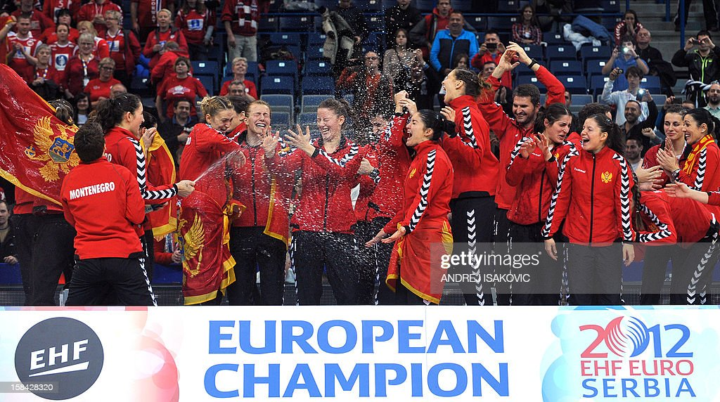 Montenegro's players celebrate after winning the 2012 EHF European Women's Handball Championship on December 16 , 2012, at the Kombank Arena of Belgrade. Montenegro won 34-31 against Norway in the twice extra-time.