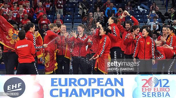 Montenegro's players celebrate after winning the 2012 EHF European Women's Handball Championship on December 16 at the Kombank Arena of Belgrade...