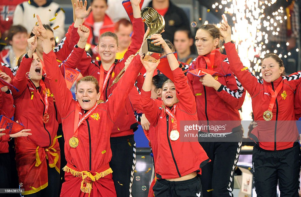 Montenegro's players celebrate with the trophy after they won the 2012 EHF European Women's Handball Championship on December 16 , 2012, at the Kombank Arena of Belgrade. Montenegro won 34-31 against Norway in the twice extra-time.