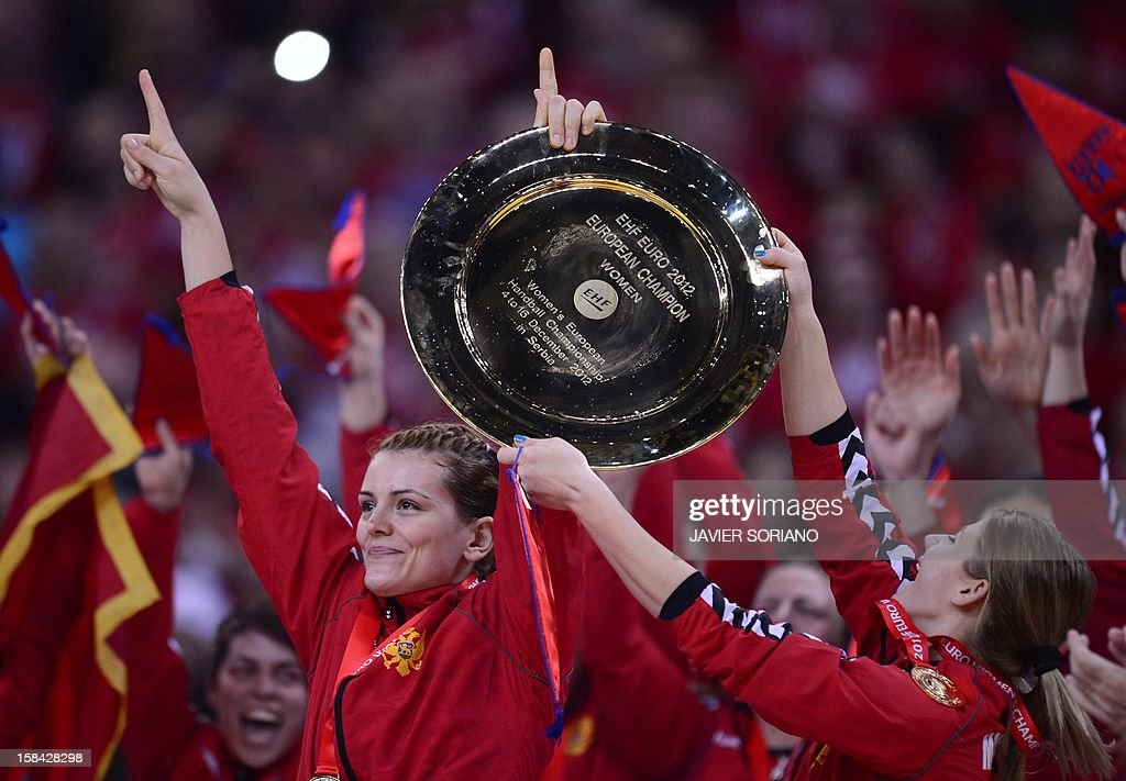 Montenegro's players hold their trophy as they celebrate their team victory after the Women's EHF Euro 2012 Handball Championship final match Norway vs Montenegro on December 16, 2012, at the Kombank Arena in Belgrade.