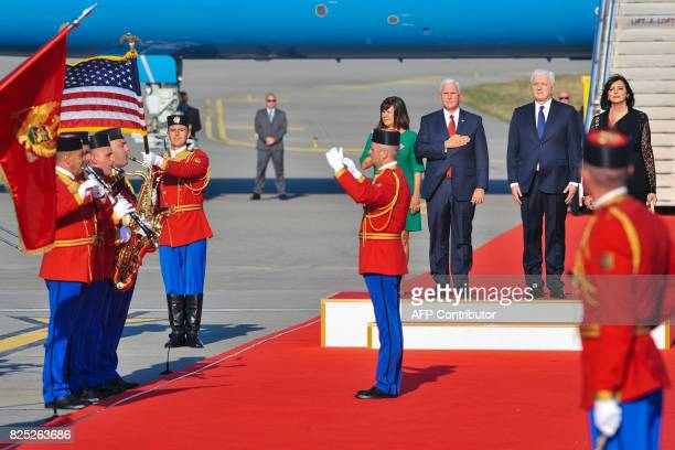 Montenegro'S Prime Minister Dusko Markovic US Vice President Mike Pence and his wife Karen Pence stand at attention as Montenegrin honor guards play...