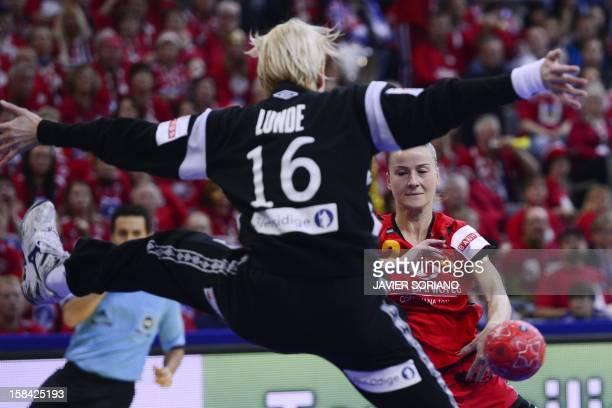Montenegro's Radmila Miljanic throws the ball past Norway's goalkeeper Katrine Lunde Haraldsen during the 2012 EHF European Women's Handball...