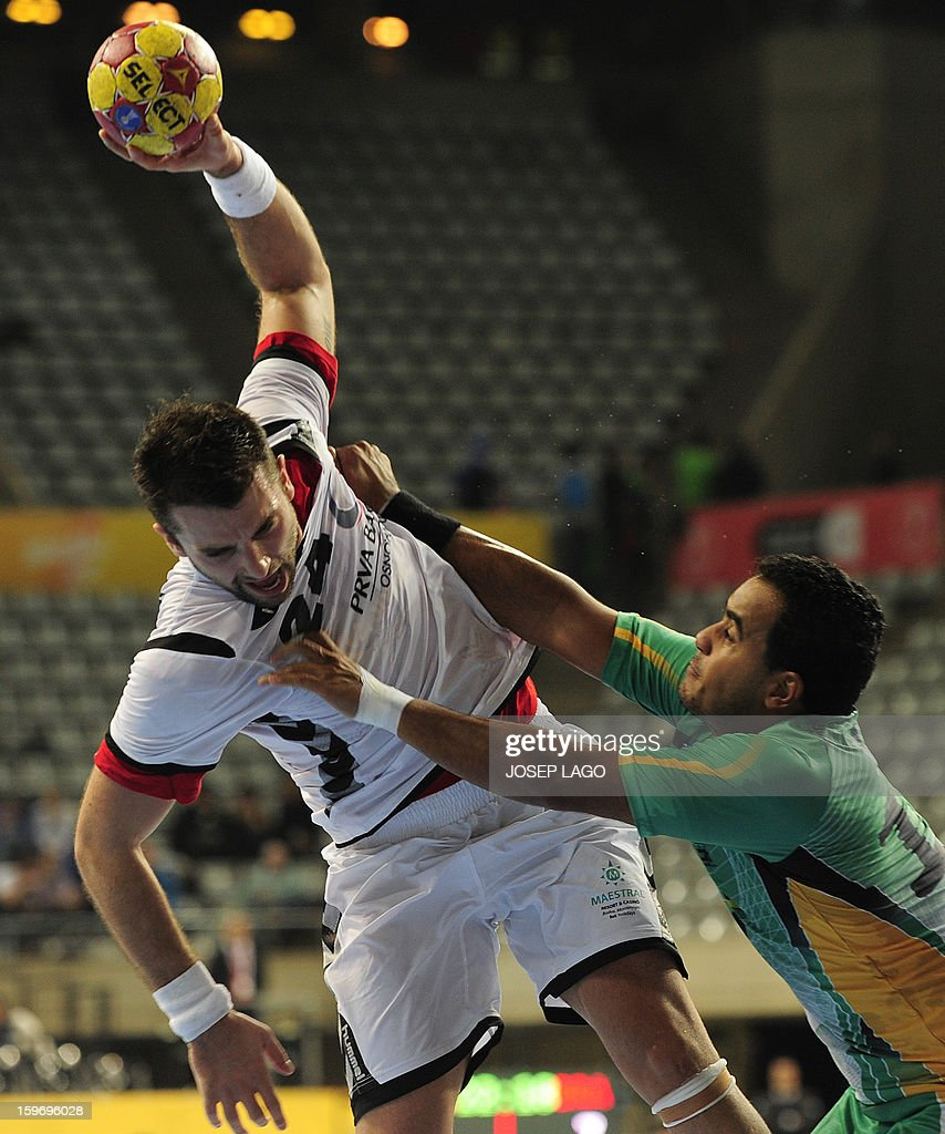 Montenegro's right back Marko Simovic (L) vies with Brazil's centre back Thiago Santos (R) during the 23rd Men's Handball World Championships preliminary round Group A match Montenegro vs Brazil at the Palau Sant Jordi in Barcelona on January 18, 2013.