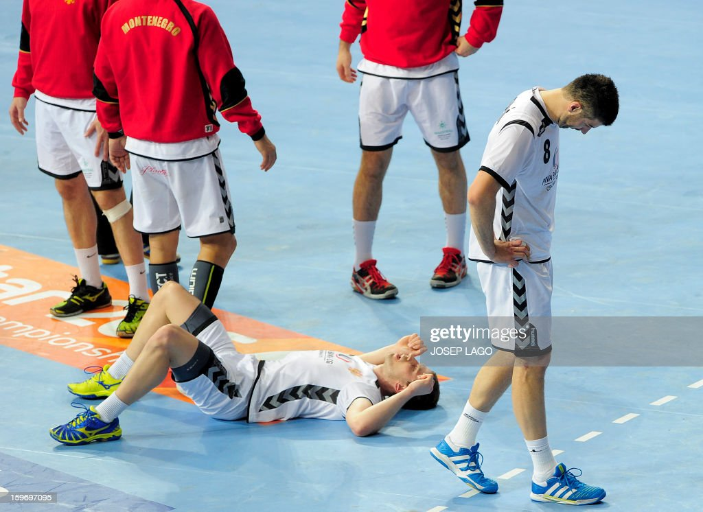 Montenegro's right wing Igor Markovic (L) and Montenegro's left back Vladimir Osmajic (R) react after the 23rd Men's Handball World Championships preliminary round Group A match Montenegro vs Brazil at the Palau Sant Jordi in Barcelona on January 18, 2013. AFP PHOTO/ JOSEP LAGO