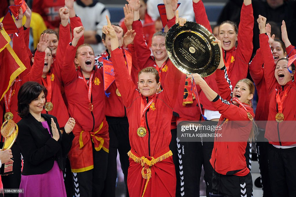 Montenegro's rightwing Jovanka Radicevic (C) and teammates celebrats with the trophy after they won the 2012 EHF European Women's Handball Championship on December 16 , 2012, at the Kombank Arena of Belgrade. Montenegro won 34-31 against Norway in the twice extra-time.