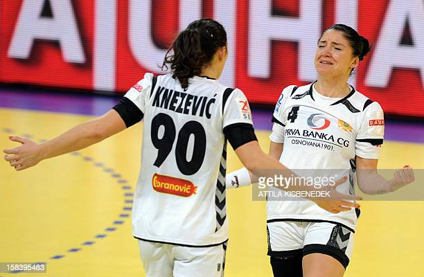 Montenegro's rightwing Jovanka Radicevic celebrates with Montenegro's Milena Knezevic after winning the 2012 EHF European Women's Handball...