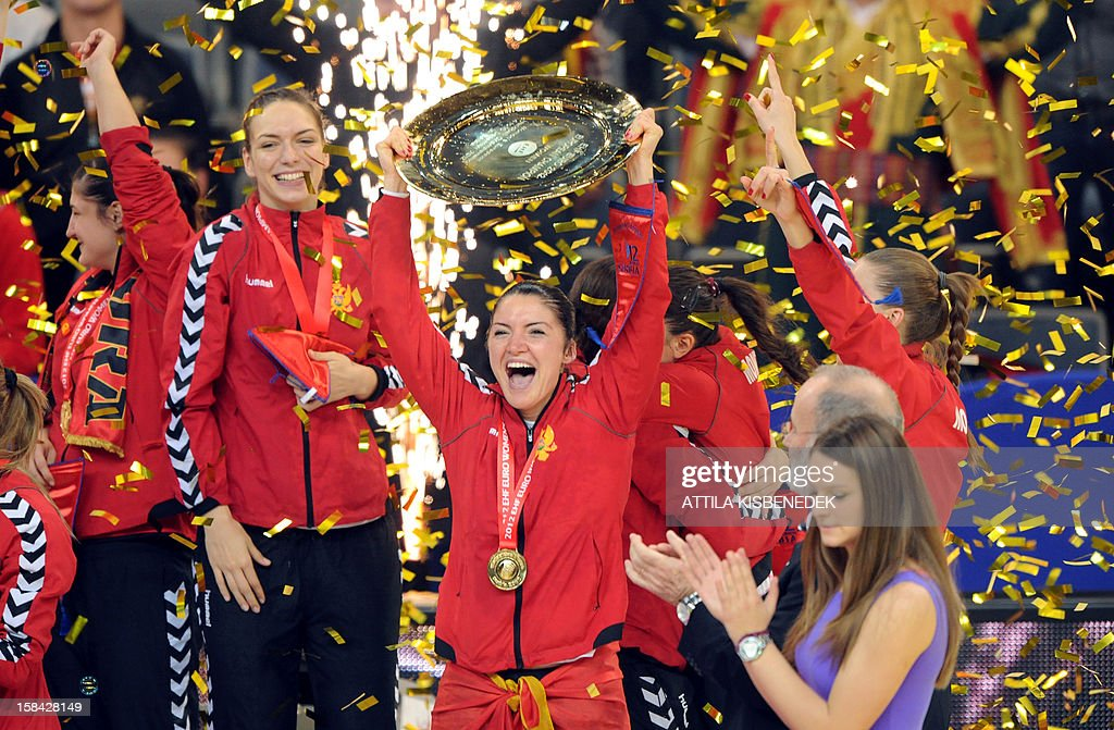 Montenegro's rightwing Jovanka Radicevic (C) celebrates with the trophy after her team won the 2012 EHF European Women's Handball Championship on December 16 , 2012, at the Kombank Arena of Belgrade. Montenegro won 34-31 against Norway in the twice extra-time.