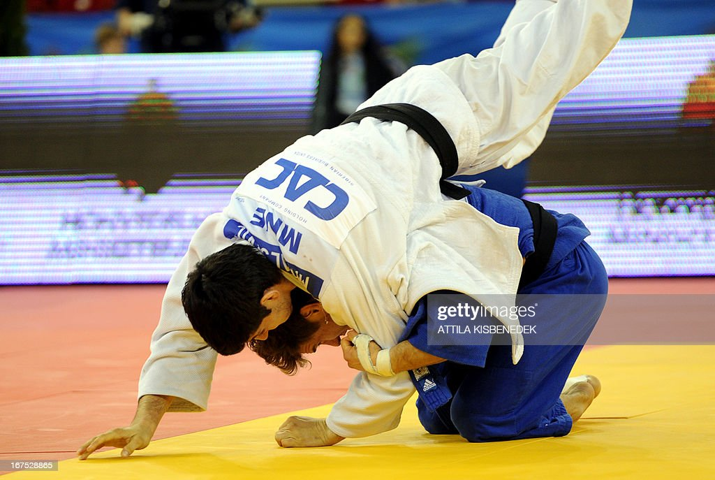 Montenegro's Srdjan Mrvaljevic (white) figths with France's Loic Pietri (blue) during their fighting of the Judo European Championships in 81kg category for men in Budapest on April 26, 2013. AFP PHOTO / ATTILA KISBENEDEK