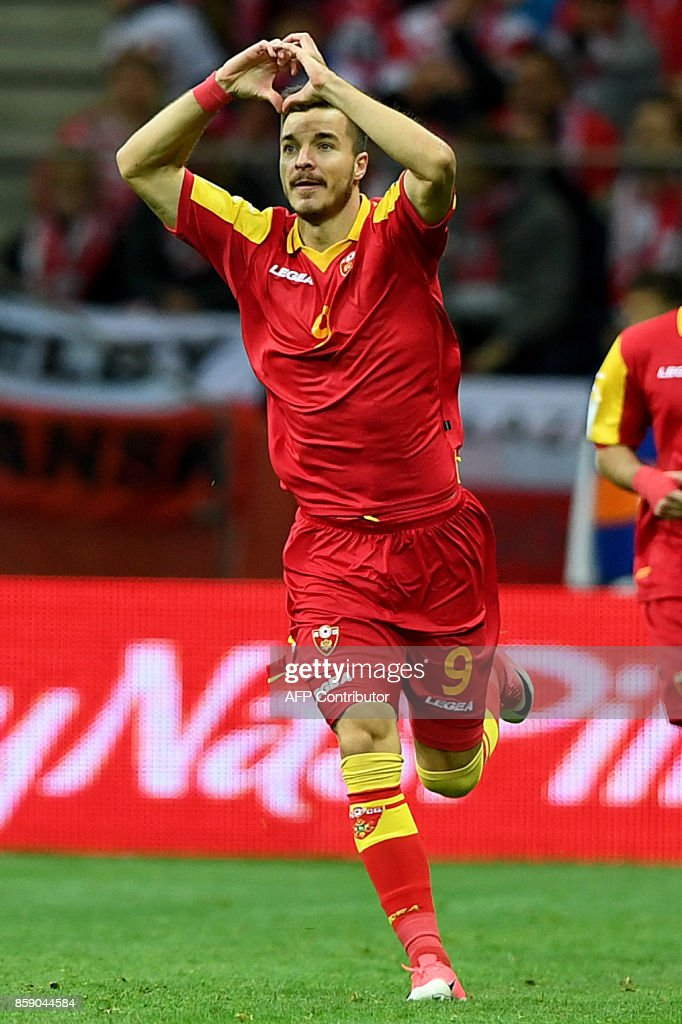 Montenegro's Stefan Mugosa celebrates after scoring during the FIFA World Cup 2018 qualification football match between Poland and Montenegro in Warsaw on October 8, 2017. /