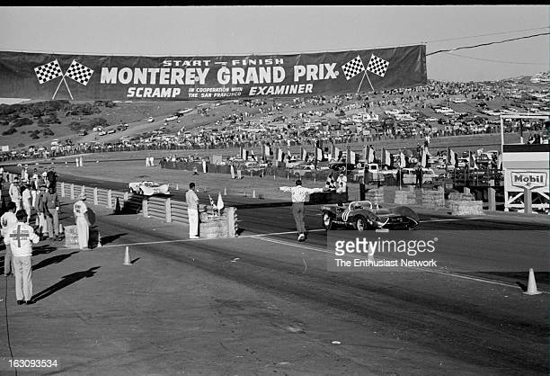 Monterey Grand Prix Race winner Walt Hansgen takes the checkered flag in a Ford powered Lola T70 Hap Sharp finishes in second in his Chevrolet...