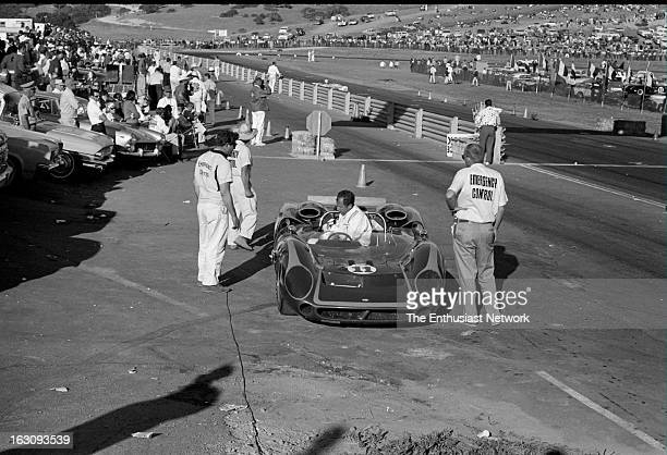 Monterey Grand Prix Rick Muther of the Pacesetter team sits off track in his Chevrolet powered Lola T70 after a mechanical failure forced him to...