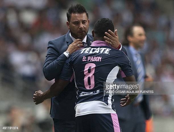 Monterrey' coach Antonio Mohamed congratulates Dorlan Pabon after he scored against Leon during the Mexican Apertura 2015 tournament football match...