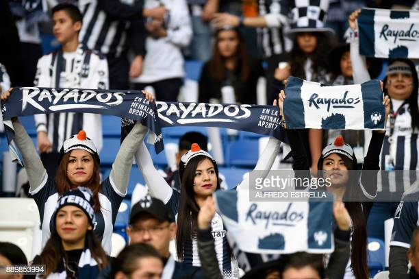 Monterrey fans cheer for their team before the start of their final Mexican Apertura 2017 tournament football match against Tigres at the BBVA...