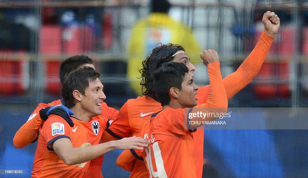 CF Monterrey midfielder Jesus Corona (R-#14) raises his arm to Mexican supporters to celebrate his goal against Ulsan Hyundai of South Korea during the first half of their 2012 Club World Cup 2012 quarter-final football match in Toyota on December 9, 2012. AFP PHOTO/Toru YAMANAKA