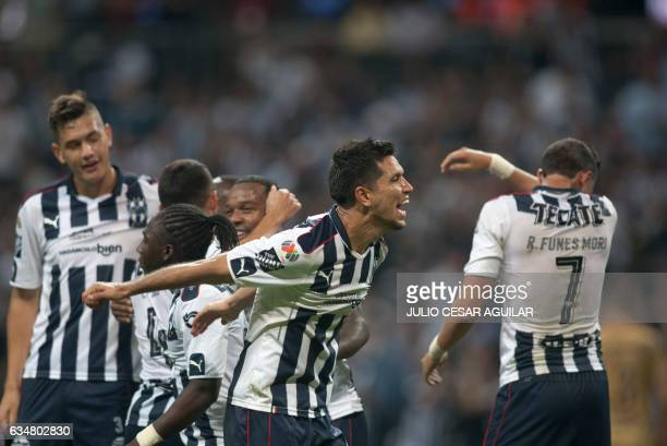 Monterrey players celebrate after scoring against Pumas during their Mexican Clausura 2017 tournament football match at the BBVA Bancomer stadium in...