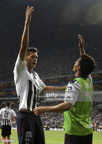 Monterrey players celebrate after scoring against Tigres during the Mexican Clausura 2017 tournament football in Monterrey Mexico on April 22 2017 /...