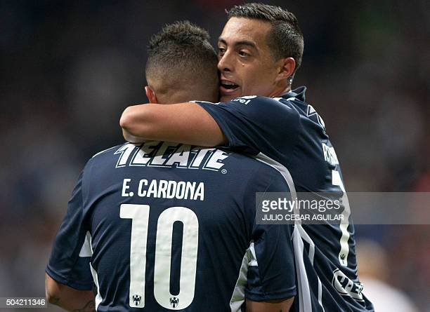 Monterrey's Argentinian Rogelio Funes Mori celebrates with a teammate after scoring against Pumas during the Mexican Clausura 2016 tournament...