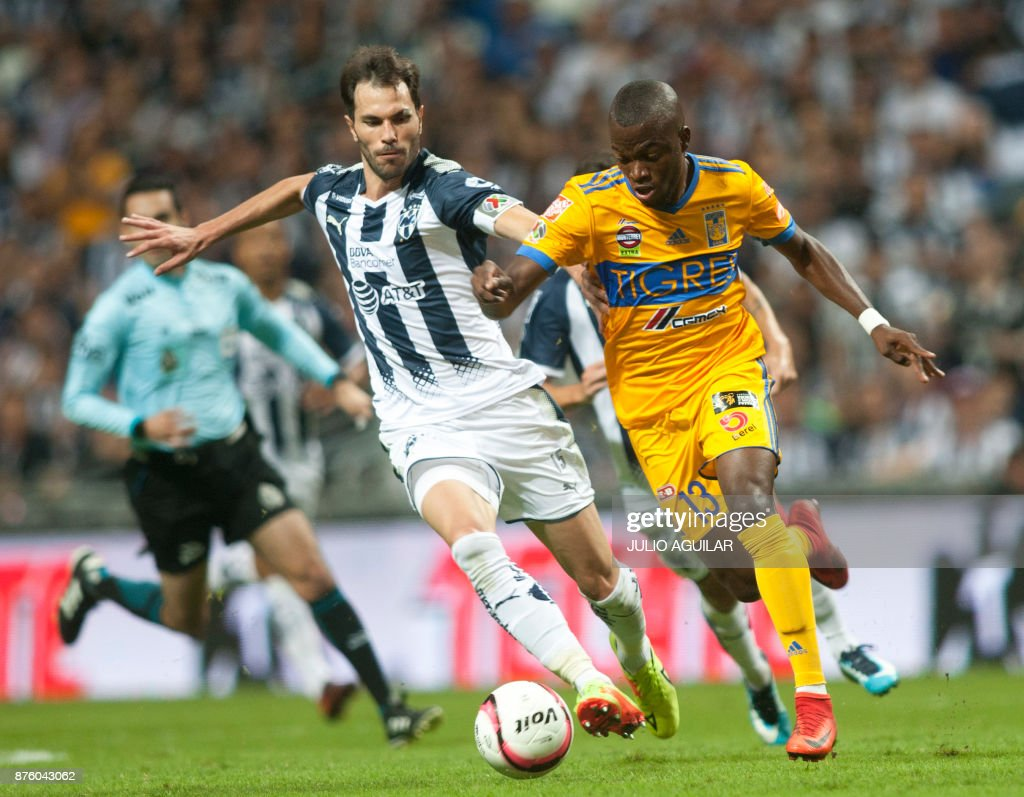 Monterrey s Jose Basanta L vies for the ball with Tigres Enner