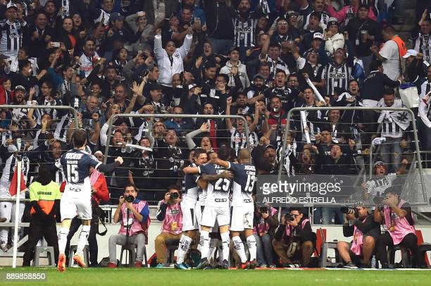Monterrey's players celebrate after scoring against Tigres during their final Mexican Apertura 2017 tournament football match at the BBVA Bancomer...