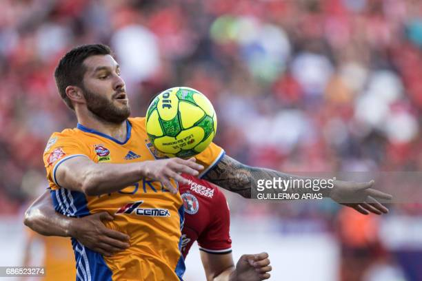 Monterrey's Tigres AndrePierre Gignac vies for the ball with Tijuana's Hiram Munoz during their Mexican Clausura 2017 Tournament second leg semifinal...