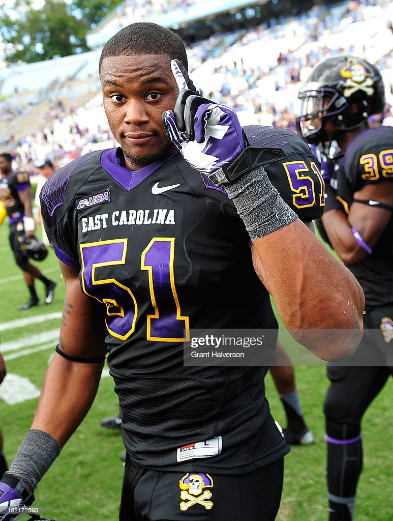 Montese Overton #51 of the East Carolina Pirates celebrates a win against the North Carolina Tar Heels at Kenan Stadium on September 28, 2013 in Chapel Hill, North Carolina. East Carolina won 55-31.