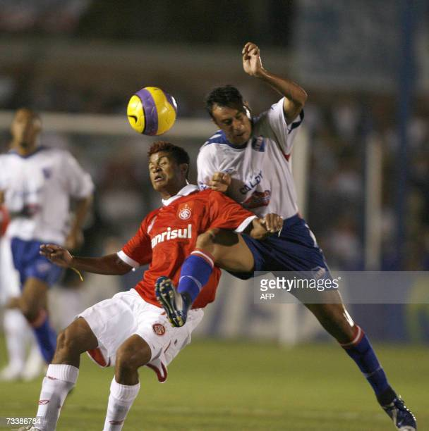 Adriano of Internacional and Alexis Viera of Nacional vie for the ball 21 February 2007 during their Libertadores Cup football match in Montevideo...