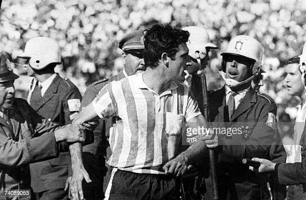 Argentinan Racing Club's Alfio Basile is escorted after gating a red card in a match against Celtic in Montevideo 1967 AFP PHOTO
